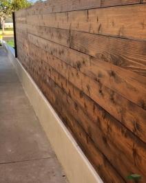 horizontal slat privacy fence | stucco wall base